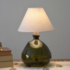 This lamp base has several unique features: made from recycled glass, it is fitted with a cotton braided flex and a cork stopper at the top for the bulb holder. Available in 3 colours Glass Lamp Base, Table Lamp Base, Lamp Bases, Table Lamps, Interior Styling, Interior Decorating, Cork Stoppers, Recycled Glass, Beautiful Homes