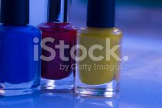 Close up of blue, red and yellow nail polish royalty-free stock photo