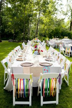 colorful ribbon chairs - love this idea - Sam mentioned doing this to only the chairs that line the isle and then reusing those chairs as the wedding party table - I think it's a brilliant idea Outdoor Wedding Chairs, Outdoor Weddings, Outdoor Tables, Lodge Wedding, Surf Wedding, Dream Wedding, Crazy Wedding, Spring Wedding, Eclectic Wedding