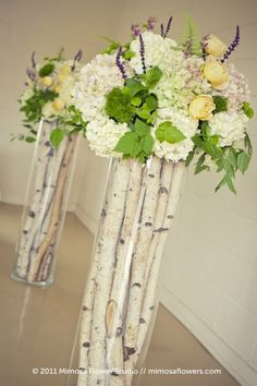 Birch branches and flowers in glass cylinders. This is gorgeous!