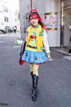 aa31364ff5a4 Guitar-playing pink-haired English-speaking Japanese high school student  Lisa on the street in Harajuku.