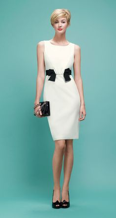 Paule Ka Sleeveless dress in satin-backed crepe with bow at the waist. Darts to front and back. Back zip fastening.