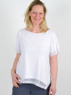 This cool mesh t-shirt belongs in every modern wardrobe. A comfy yet edgy style that elevates workwear, to dressy separates, to casual looks. Solid, soft jersey lining. Angled shirt-tail hem. Pairs perfectly with the Cadence Skirt. Mesh T Shirt, Modern Wardrobe, Edgy Style, Separates, Workwear, Casual Looks, Tunic Tops, Comfy, Pairs