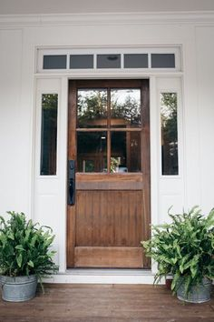 Natural stain on door with white painted trim and windows.