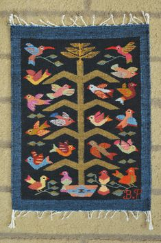 This delightful miniature weaving was made by master weaver Bulmaro Perez from Teotitlan del Valle, Oaxaca Mexico