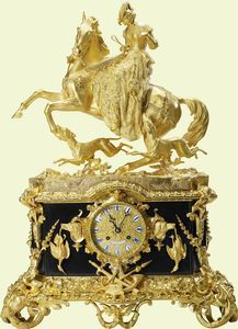 Mantel clock    c.1849-57, Miroy Frères    Probably purchased by Prince Albert  Gilt bronze, brass, slate, enamel    73 × 51 × 24 cm