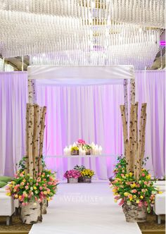 birch wood huppa and spring flowers  photo by SweetPea Photography  decor Art of the Party;  Flowers by http://www.fiorire.ca