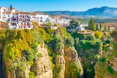Ronda is a unique hilltop town in Andalusia, Spain built right on the edge of a cliff! Here are the best things to do in Ronda Spain. The Places Youll Go, Places To See, Andalusia Spain, Andalucia, Ronda Spain, Places To Travel, Travel Destinations, Travel Tips, Prague Travel