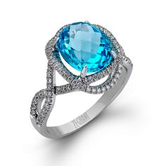White diamond arms of .41ctw wrap around a single 4.0ct oval Blue Topaz in 14K white gold making this ring a bold addition to the Refined Rebel Collection.