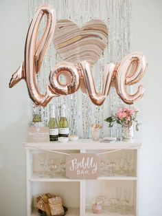 """Elegant bridal shower decor idea - Bubbly bar with rose gold """"LOVE"""" balloon and sparkle backdrop {Courtesy of Etsy} Love Decorations, Gold Wedding Decorations, Bridal Shower Decorations, Decor Ideas, Decoration Party, Decor Wedding, Wedding Themes, Ballon Party, Bubbly Bar"""