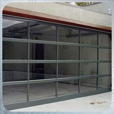 "glass garage door.  perhaps could be used for a living room ""wall"", to make room into an indoor/outdoor room during warm weather."