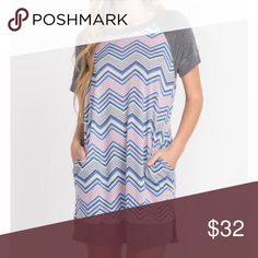 Zig Zag Baseball Tee Dress How fun and unique is this zig zag pattern?!  Hit the town this spring and stand out in this cute and comfy dress!  65%Polyester, 35%Rayon Made in USA.  S,M,L - true to size Dresses Midi