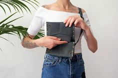 Simple and beautiful bag made of a high quality leather. Perfect for festivals, markets and travelling. It is a great way to go hands free. This leather hip bag is perfect for biking around town, festivals, fairs, concerts and farmers markets. Created with a simple timeless design which blends with any style.  The bag can carry a phone, cash, cards plus a few other essentials and can be worn on your hip, over the shoulder or tight under your arm. The flexible strap This leather will patina…