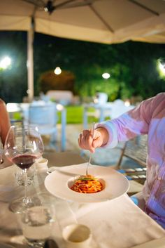 If you are visiting Sicily, be sure to make time for dinner at this beautiful romantic restaurant. #hotel #travel #sicily #italy #pasta #food