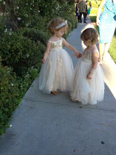 The sweetest little flower girl dresses! Love the gold color and they're full of glitter - best part is these dresses come in pink too! Perfect for all girly brides looking for a unique flower girl dress for their cocktail, modern, gold, pink, vintage, classic or romantic wedding