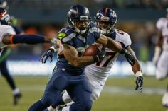SEATTLE, WA - AUGUST 14:  Running back Thomas Rawls #34 of the Seattle Seahawks rushes for a touchdown in the fourth quarter  against the Denver Broncos at CenturyLink Field on August 14, 2015 in Seattle, Washington. The Broncos defeated the Seahawks 22-20.  (Photo by Otto Greule Jr/Getty Images)#GoHawks #SeahawksSB50 #SuperBowl3Pete