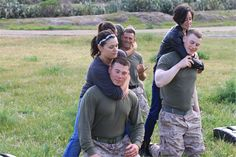 Camp Pendleton, Ca - Amanda Lintz executes a choke hold on her husband, Cpl. Jason Lintz, a squad leader serving with Golf Company, 2nd Battalion, 4th Marine Regiment, during the battalion's Jane Wayne Day here, March 16, 2013. The spouses and family memmembers were able to participate in Marine Corps Martial Arts Program instruction, live fire ranges, and going through the obstacle course.