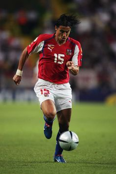 Milan Baros of Czech Republic runs with the ball during the UEFA Euro 2004 Group D match between Germany and Czech…
