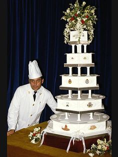 "Princess Diana's wedding cake (over 5 feet tall) decorated with royal icing and Windsor Royal coat of arms (made of marzipan) and an ornamental ""C"" and ""D"" and flowers including roses, lilies of the valley and orchids. Made by David Avery from the Royal Navy Cookier School."