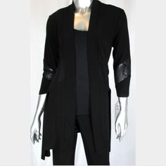Joseph Ribkoff black cardigan size 8 Open front. Long cut with hem to the mid-thigh. Decorative paneling around waist features a translucent, floral print. Three quarter length sleeves. Hemline flares out after the fitted waist. A gorgeous piece.  Mint condition. Joseph Ribkoff Other