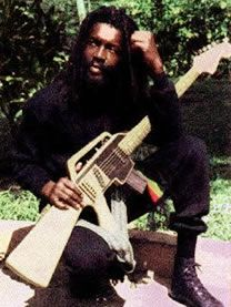 Peter Tosh and his M-16 guitar. He said he had it made because music is his weapon.