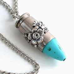 "very cool pendant made from a spent nickel shell casing with a turquoise ""bullet.""  plus the rest of the shop is awesomely steampunk."