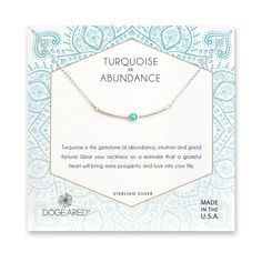 """sterling silver and turquoise balance bar necklace on message card reads, """"Turquoise is the gemstone of abundance, opulence and wealth. Wear your necklace to bring good luck into your life, and as a reminder to always be grateful."""" turquoise jewelry"""