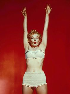 Marilyn in a white fringe two-piece swimsuit.