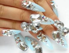 What is this? Crazy bling! I need this girl to cut the talons down a bit though-not a fan of pointy claws.