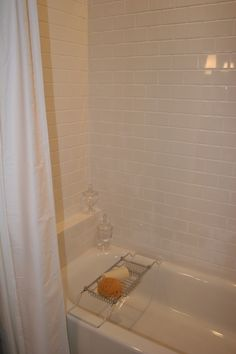 Like the built in shower shelf and the subway tiles