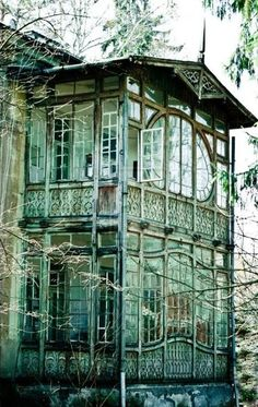 Abandoned conservatory. Imagine what it must have looked like before the owners left. I picture it filled with plants, and glowing with lantern light and candles.