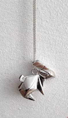 Perfect for Easter!  This little origami inspired bunny charm is so cute! https://www.facebook.com/pages/Chris-Alix-Custom-Jewelry/187194701308962