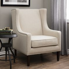 Update your home decor with this elegant, cream-colored linen wingback chair. The wingback chair has a classic look with trendy nailhead accents that add interest and detail to your home decorating st