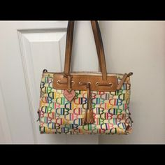 Authentic Donney & Burke purse! Purse is the perfect size with the signature Dooney & Burke look! I have hand washed the outside of purse and it's spotless, no pens marks, scratches. Slight discoloration and pen marks inside the purse but who's going to look inside the purse besides you!? Dooney & Bourke Bags Shoulder Bags