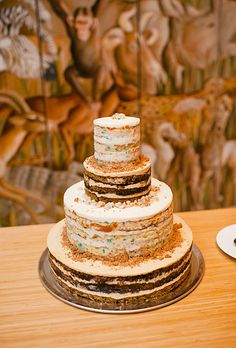 "Momofuku Milk Bar  designed a four-tier wedding cake made with layers of chocolate pretzel and birthday cake. ""They don't really frost the outsides of the cakes,"" the bride explains. ""They just look kind of unfinished and super cool."""