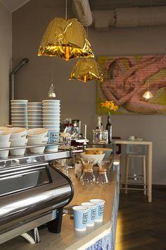 Balthasar Kaffee Bar in Vienna, Austria is designed by Eugenie Arlt. Eugenie specified the Hakwood Genuine flooring, Retired for the finishing touch. Vienna Austria, Herringbone, Kitchen Appliances, Ceiling Lights, Flooring, Spaces, Bar, City, Design