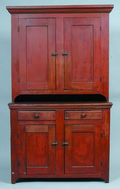 "oftwood Sindle Part Blind Door Step Back Cupboard with molded cornice, two paneled doors above two dovetailed drawers over two lower paneled doors and cut out feet, all with old red paint, (restoration to back feet, surface with losses and scratches), 83"" x 49-3/4"" x 19-3/4""."