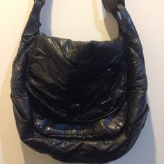 Black Textured Shoulder Bag Black leather, wrinkled textured, pocket under the front flap and also pocket within. Snap closure. From Divided! In new condition. Strap is adjustable. Divided Bags Crossbody Bags