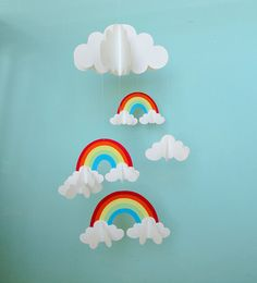 Three rainbows flow dreamily amoung the clouds in this adorable 3D mobile. Made of card stock paper, the clouds and rainbows are light enough to be