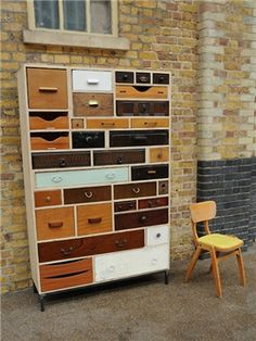 Large bank of up cycled drawers presented in a recycled packing case carcass.