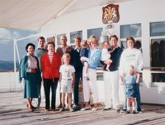 Photograph of the Royal Family on board HMY Britannia. From left to right: HRH Princess Margaret (1930-2002), HRH Prince Andrew (b. 1960), HM Queen Elizabeth II (b. 1926), HRH The Duke of Edinburgh (b. 1921), Peter Phillips (b. 1977), HRH Prince Edward