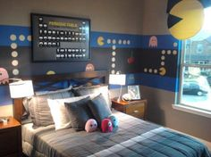 Pacman themed bedroom is perfect for any geek! Or nerd, judging by the framed periodic table. And look at the adorable ghost plushies! This teenager's room rocks!