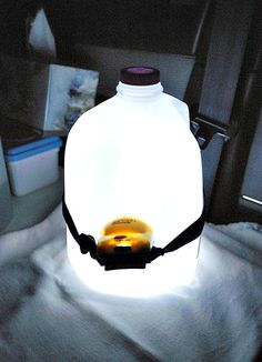 Homemade Night Lamp - A headlight around a gallon jug of water makes a great light when the power is out, or use it for camping.