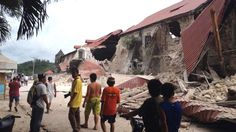 People walk past damaged Church of San Pedro in Loboc, Bohol Province, Phillipines after a earthquake struck the region At least 82 are dead and many churches damaged. Alex Johnson NBC News/Robert Michael Poole AFP-Getty Bohol, Philippines Earthquake, United States Geological Survey, Top Stories Today, Visayas, Severe Storms, Asia News, Nature, Planets