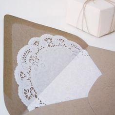 Lace Doily Lined Invitation Envelopes... I might try to do this myself but know where to find them if I need back up! (Set of 10). $ 9.50, via Etsy.