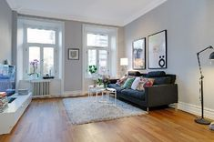 living room: love the walls and windows, dark couch and fluffy rug