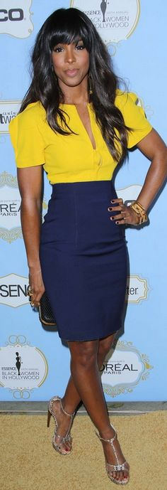 Who made  Kelly Rowland's yellow short sleeve top and blue skirt that she wore in Beverly Hills on February 21, 2013?