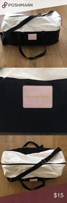 Victoria's Secret travel bag This is a pink, back, and white VS travel bag. Perfect for packing overnight or for the beach! The zipper works great but may be missing a longer piece, however, it could have come like that as well since I've never used it, it has just been stored! Remember to fill this up with other items from my closet 😉😘 Victoria's Secret Bags Travel Bags