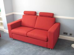 Cute two seat sofa with a couple of headrests for extra neck/head support.  This Laburnum looks lovely in red fabric.
