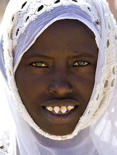 Afar beautiful girl with sharpened teeth, Danakil, Ethiopia
